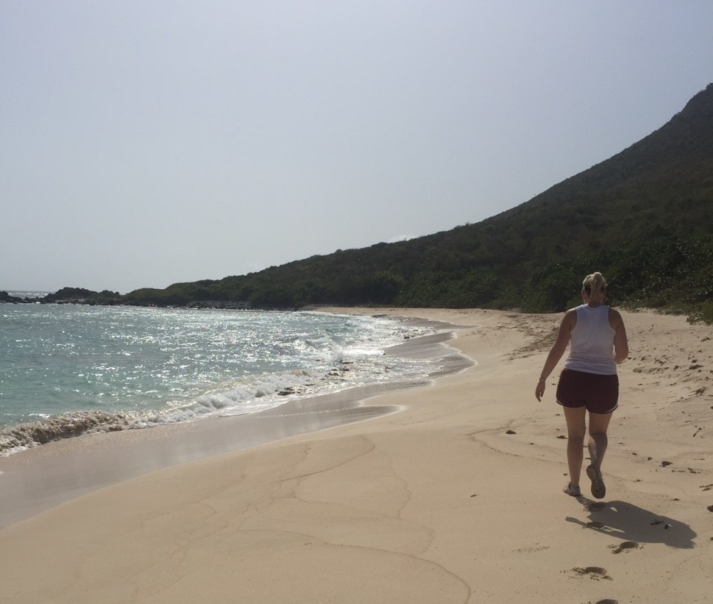 """Katherine walking on the first beach we hiked to - """"Hiking in St. Martin"""" - Two Traveling Texans"""