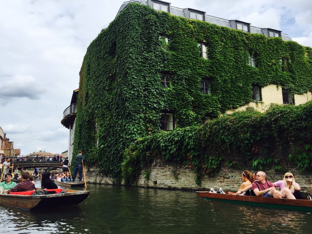 """Punting on the Cam river by an ivy covered building - """"Punting in Cambridge, England – And I am not Talking about Football"""" - Two Traveling Texans"""