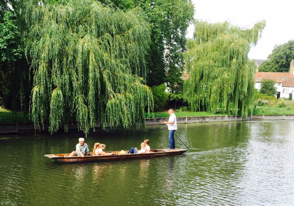 """Family punting on the Cam River - """"Punting in Cambridge, England – And I am not Talking about Football"""" - Two Traveling Texans"""