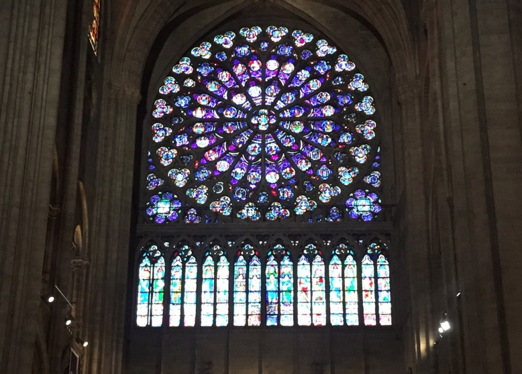 "Beautiful stained glass inside Notre Dame. - - ""Morning with Gargoyles at Notre Dame de Paris"" - Two Traveling Texans"