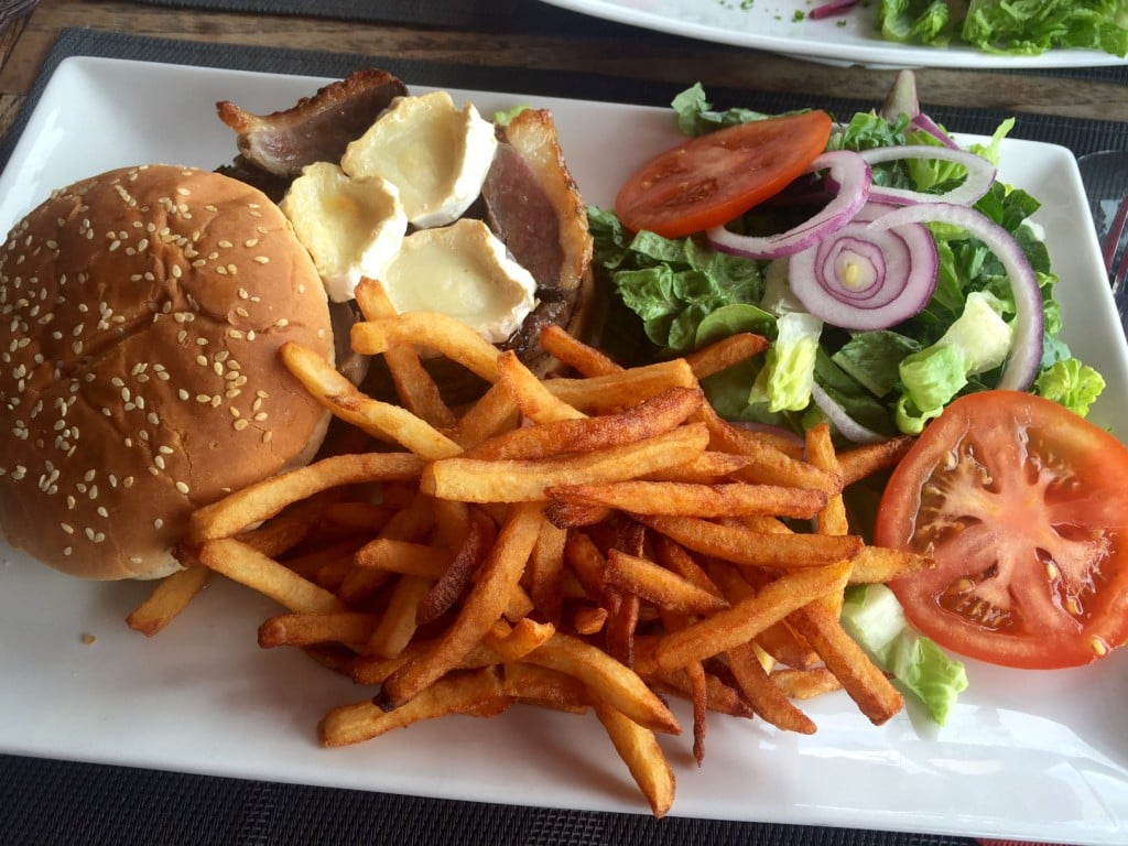 """Burger topped with duck and brie and of course lots of fries. No room for the salad....- """"Our Five Favorite Restaurants in St Martin"""" - Two Traveling Texans"""