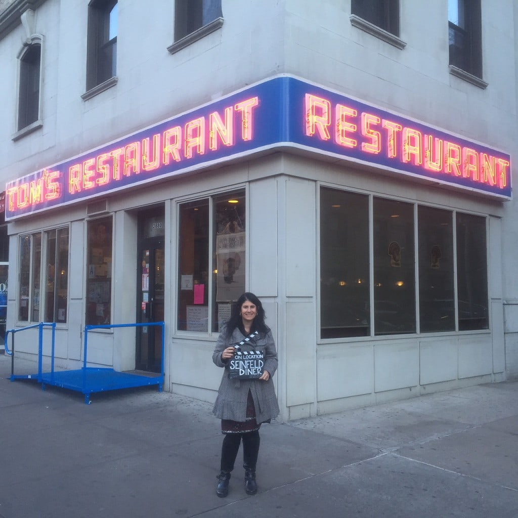 Anisa in front of the restaurant from Seinfeld