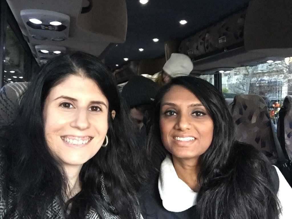 Anisa and her friend, Teju, on the bus for the When Harry Met Seinfeld Tour