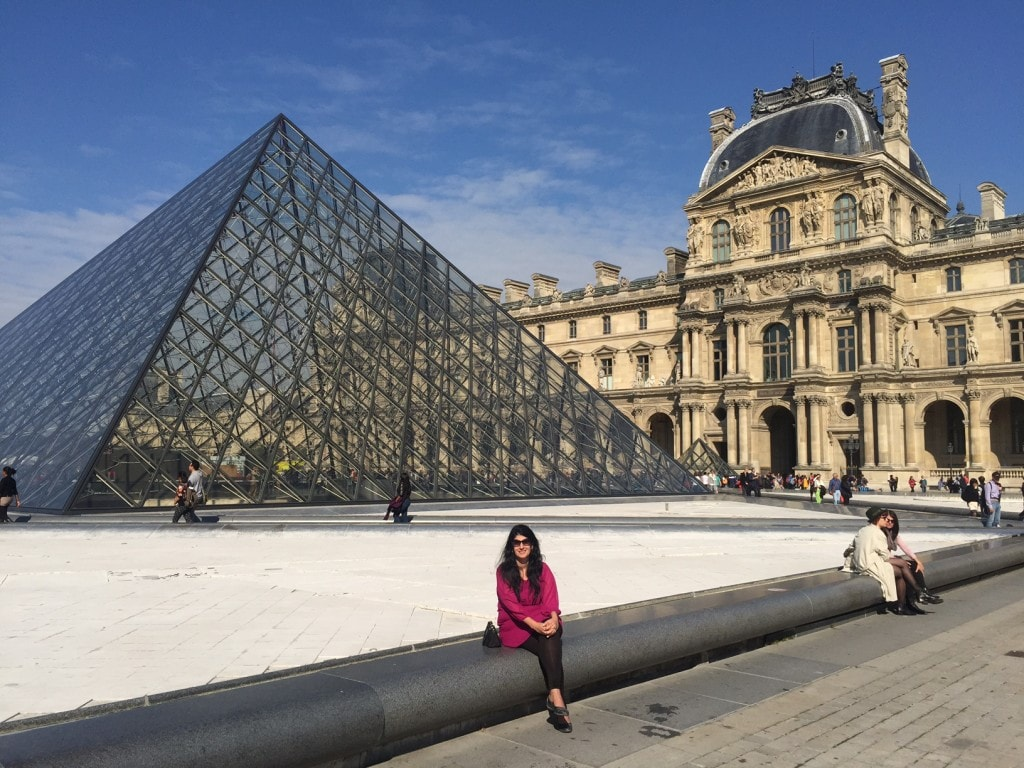 Anisa in the courtyard of the Louvre.