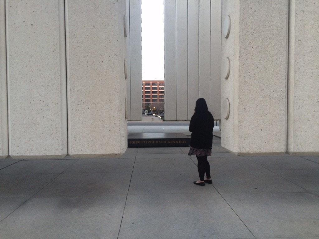 Anisa contemplating at the JFK Memorial.