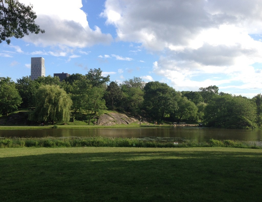 """The Harlem Meer on a beautiful summer day. - """"The Hidden Gems in Northern End of Central Park"""" - Two Traveling Texans"""