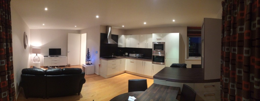 "A panoramic of the living room and kitchen at our CityStay apartment. - - ""Punting in Cambridge, England – And I am not Talking about Football"" - Two Traveling Texans"