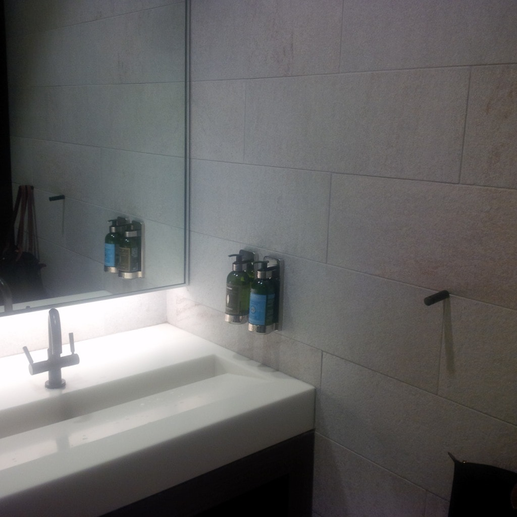 """The bathroom with L'Occitane products - """"The Centurion Lounge - Making the Best of a Long Layover"""" - Two Traveling Texans"""