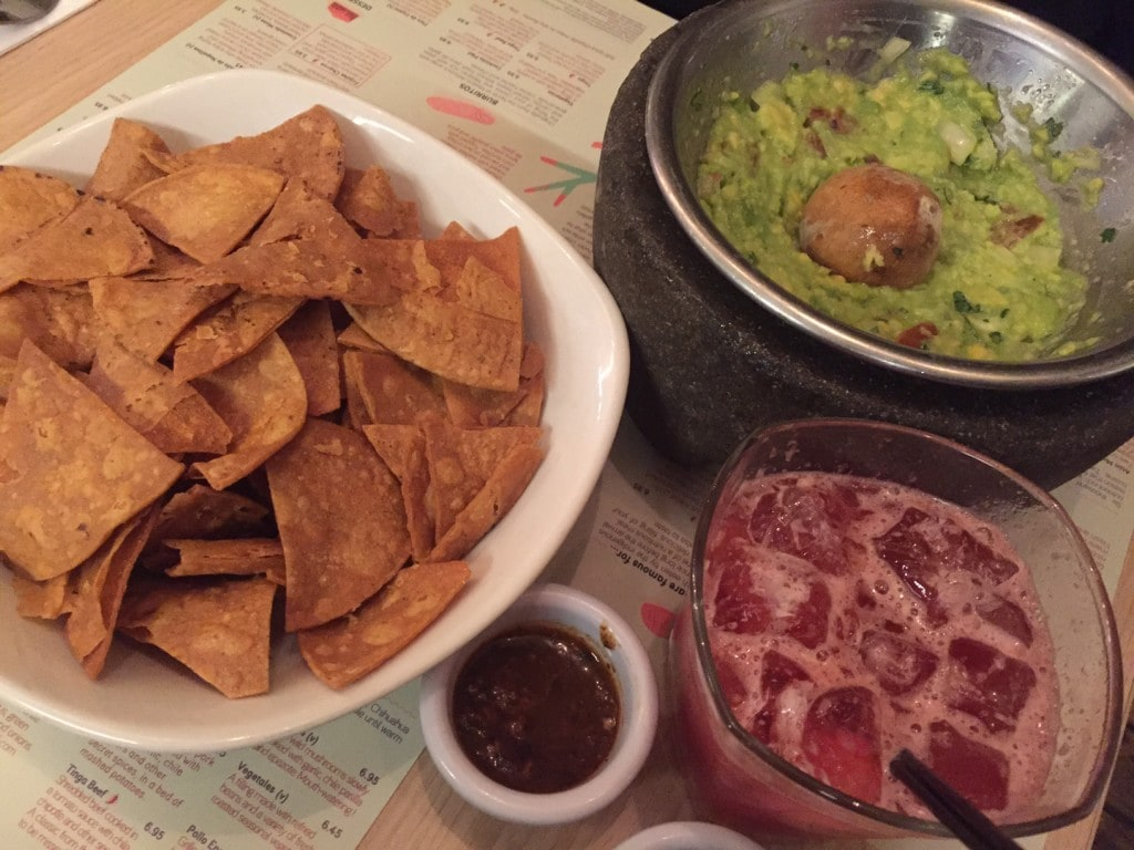 """The tableside guacamole, chips, and a strawberry margarita - """"Mexican Food Finds in London"""" - Two Traveling Texans"""