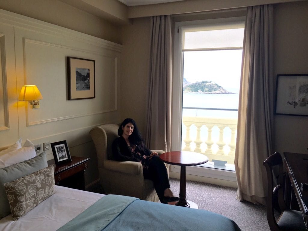 Anisa relaxing in her sea view room at the Hotel Londres in San Sebastian