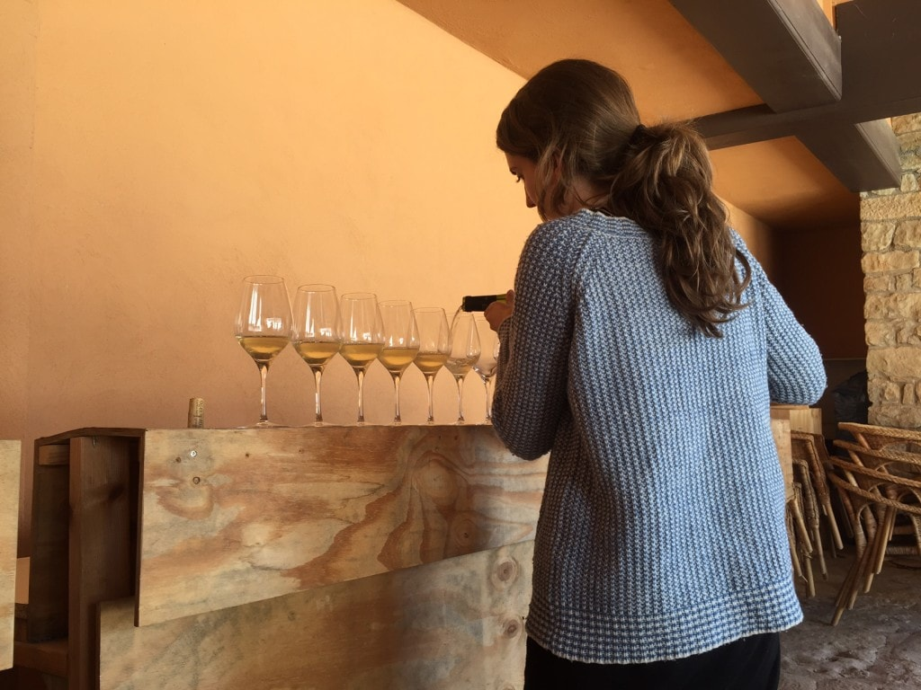 "Clara pours our first glass of wine. - ""Montserrat: Mountain, Monastery, and Wine"" - Two Traveling Texans"