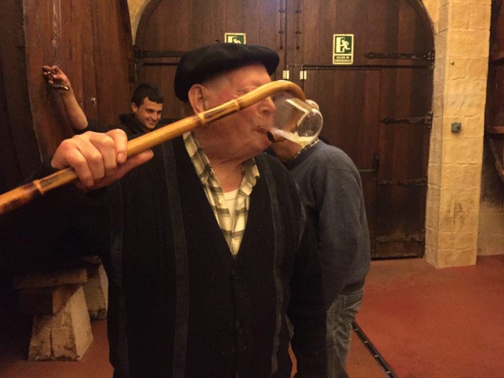 "Ilario drinking using his cane - ""Petritegi Cider House Rules"" - Two Traveling Texans"