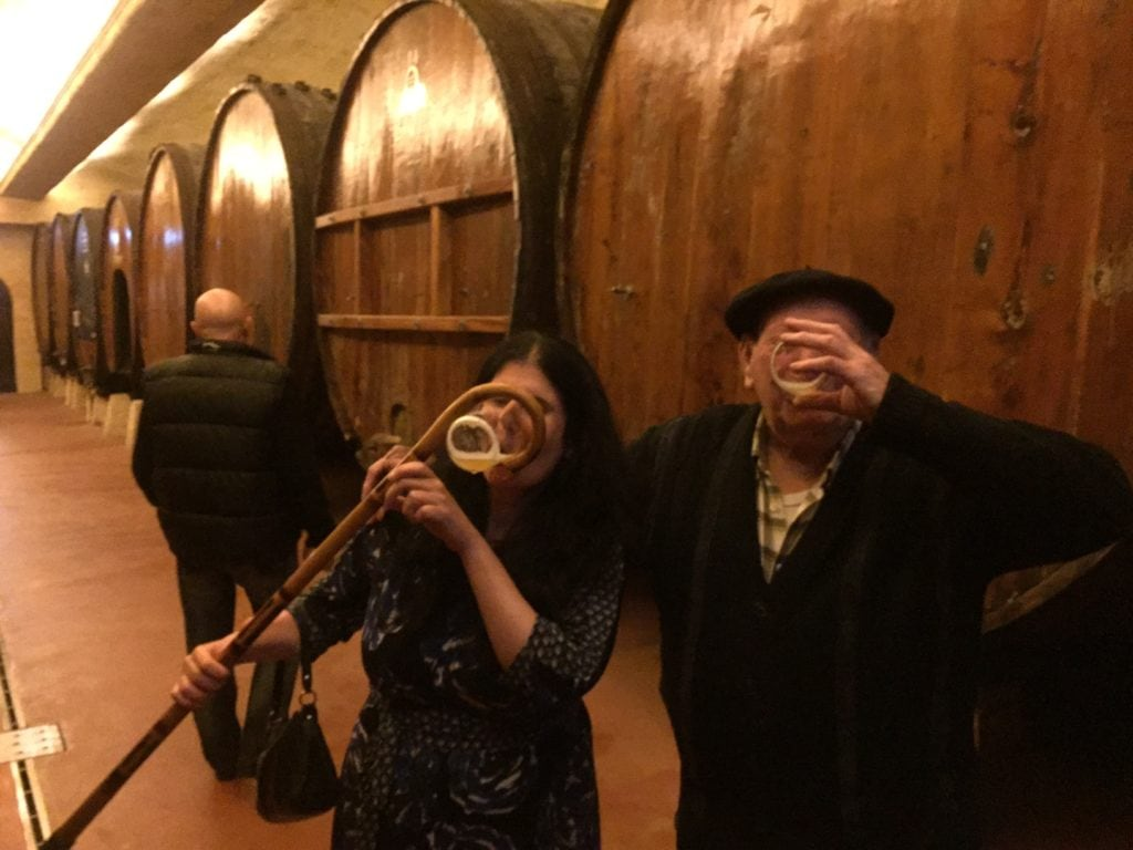 """Anisa having a drink with Ilario - """"Petritegi Cider House Rules"""" - Two Traveling Texans"""