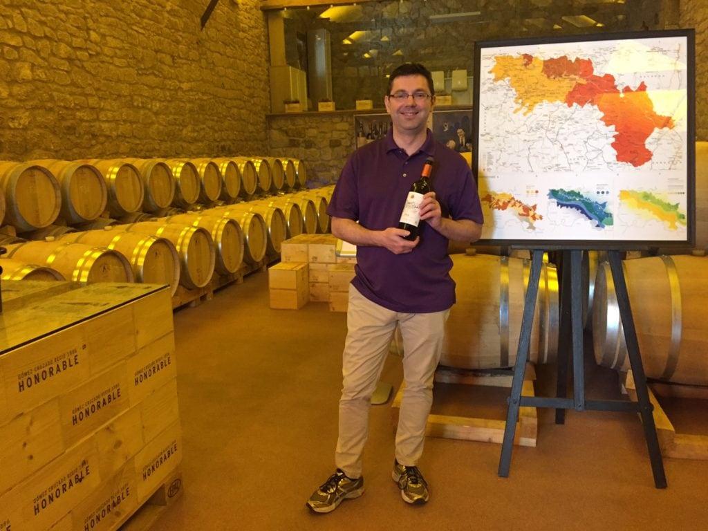 Russell modeling the Gomez Cruzado wine.
