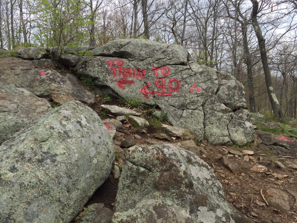 """Red writing on the rock to signal the turnoff to go back to the Breakneck Ridge Train Station. - """"Breakneck Ridge Lives Up To Its Name"""" - Two Traveling Texans"""