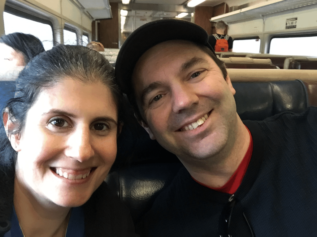 "All smiles on the train ride home from Breakneck Ridge, but let me tell you, we were exhausted! - ""Breakneck Ridge Trail Lives Up To Its Name"" - Two Traveling Texans"