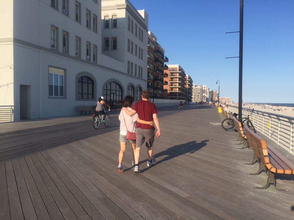 A couple walking along the boardwalk in Long Beach