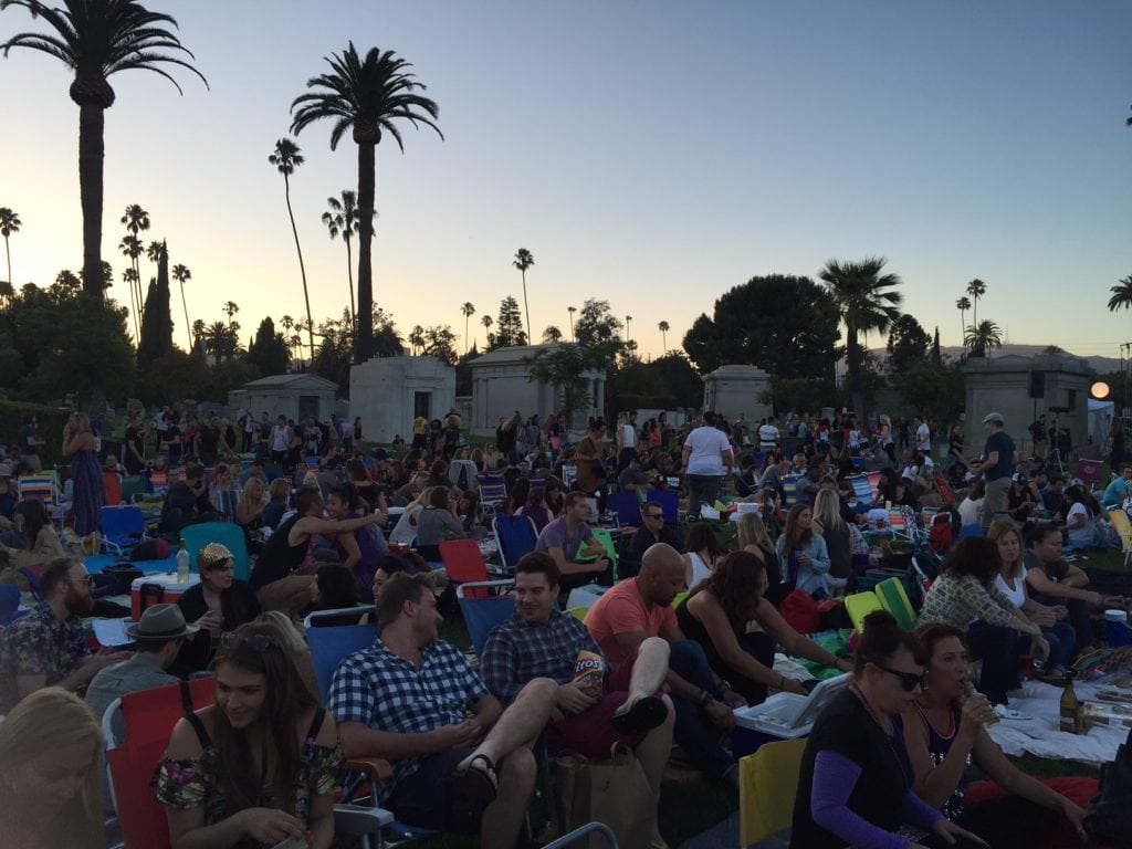 Everyone having a great time waiting for the sun to go down so the movie can start.