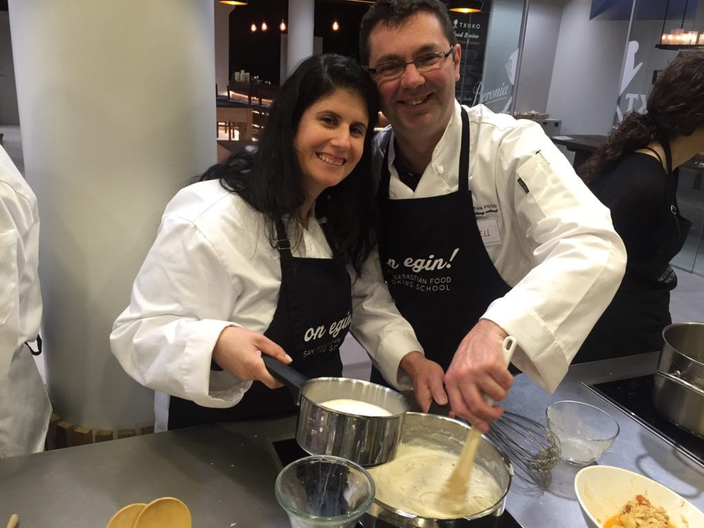 Posing for a picture while we are making croquetas during our pintxos cooking class