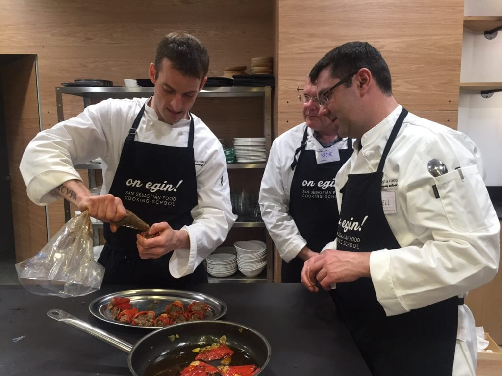 Learning how to stuff peppers at our Pintxos cooking class