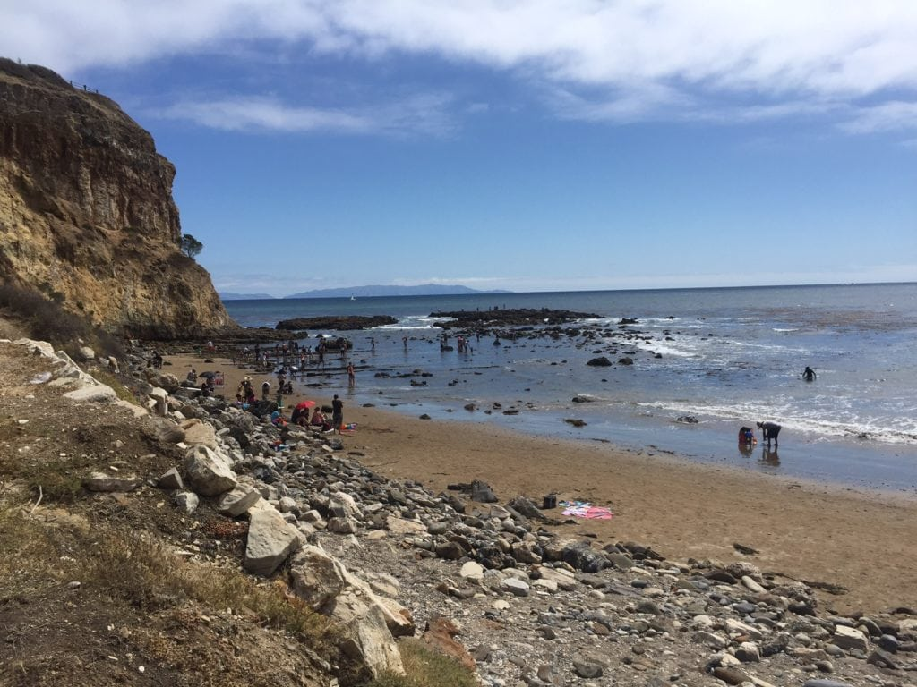 Walk along the rocky beach and then you will reach the tide pools.