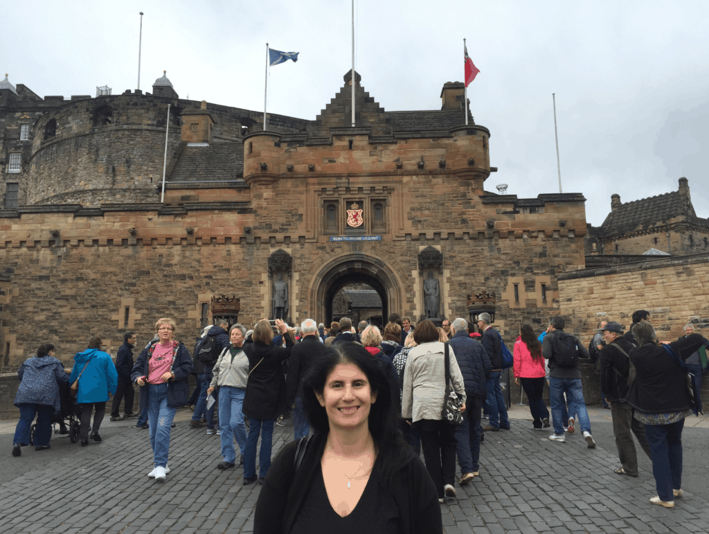 "Anisa in front of the entrance to Edinburgh Castle. - ""Experiencing History at Edinburgh Castle"" - Two Traveling Texans"
