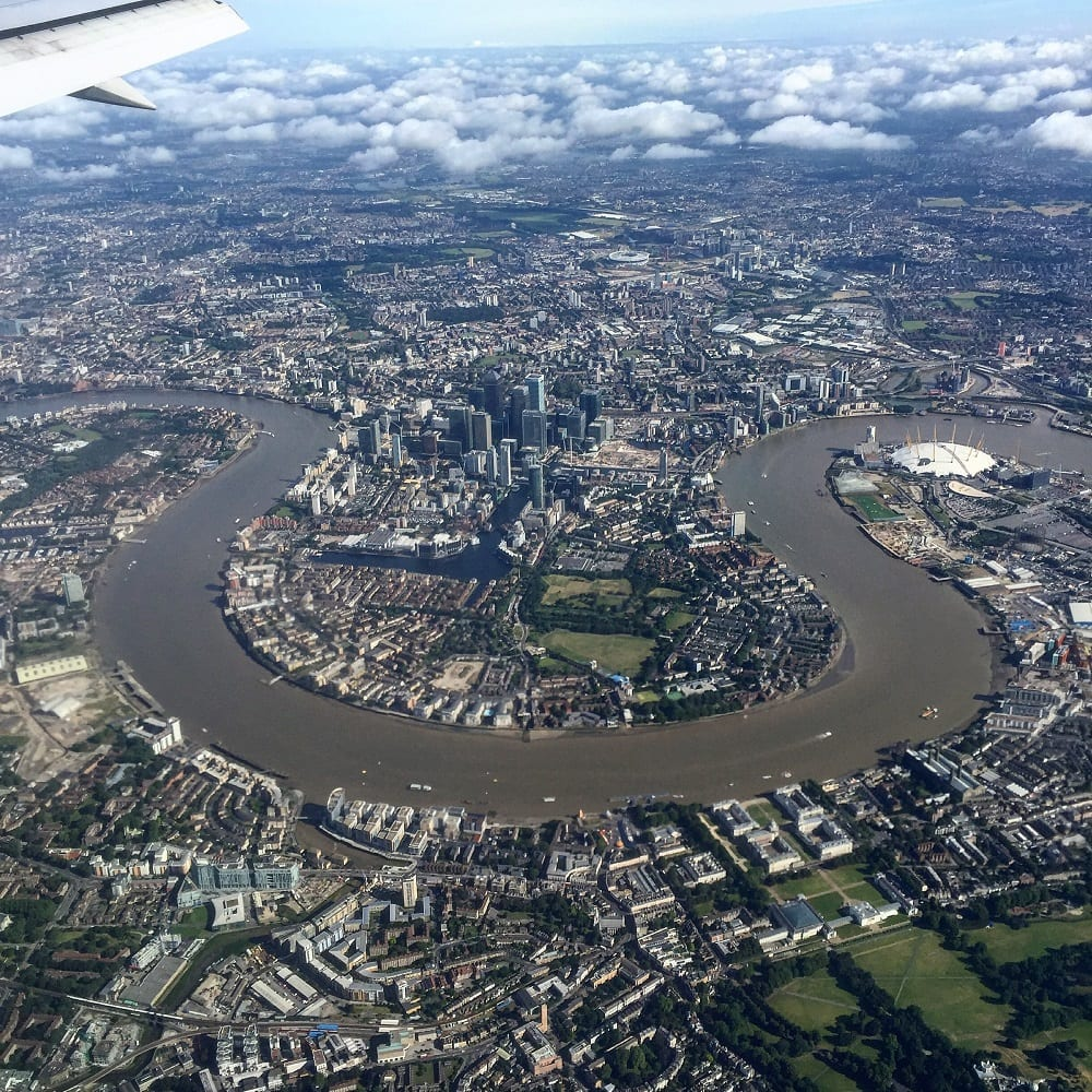 """Enjoying a nice view of London from my window seat (which I did not pay extra for!) - """"Travel Fees We Hate and How to Avoid Them"""" - Two Traveling Texans"""