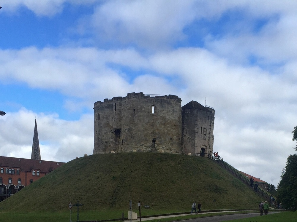 """You can't miss Clifford's Tower perched on top of the hill. - """"York: Five Must See Historic Sites"""" - Two Traveling Texans"""