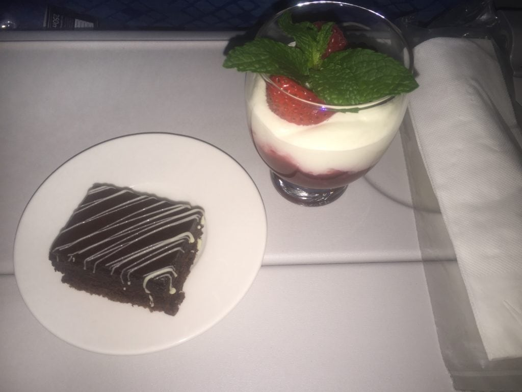 "Desserts from First Class. A brownie and fruit parfait. Yummy! - ""Random Acts of Kindness - Spark Hope Tag"" - Two Traveling Texans"