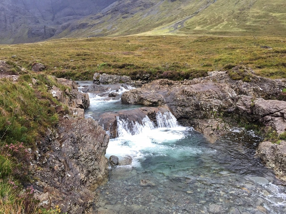 "The water is crystal clear! - ""The Magical Fairy Pools in Isle of Skye, Scotland"" - Two Traveling Texans"