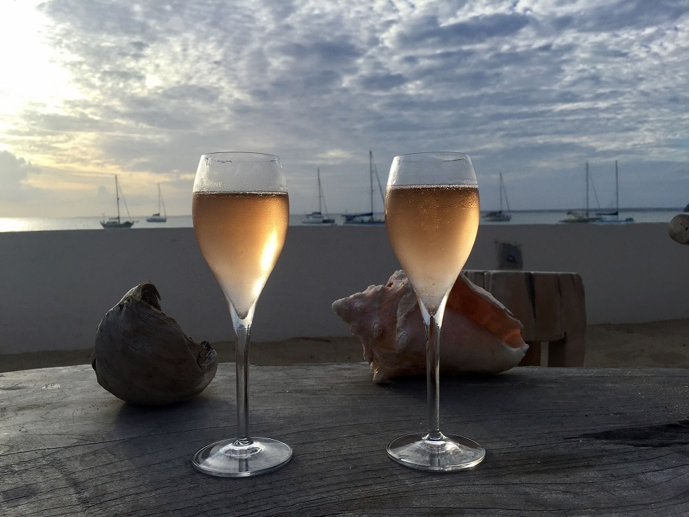 """With the money we saved on fees we could have some wine when we landed in St. Martin. - """"Travel Fees We Hate and How to Avoid Them"""" - Two Traveling Texans"""