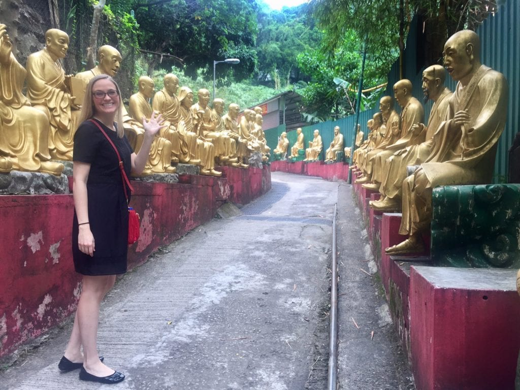 """Courtney, as we begin the climb up the Buddha lined path. - """"The Truth about the 10000 Buddhas Monastery"""" - Two Traveling Texans"""