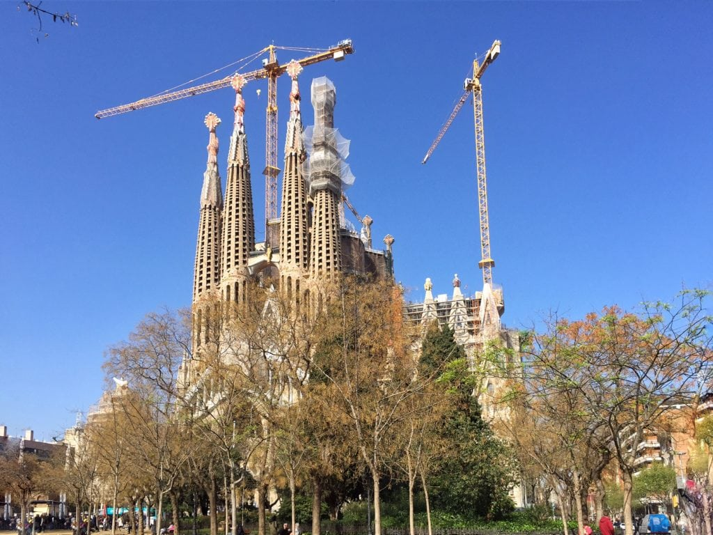 "La Sagrada Familia under construction for the last 130 years! - ""Why I Fell in Love With Gaudi in Barcelona"" - Two Traveling Texans"