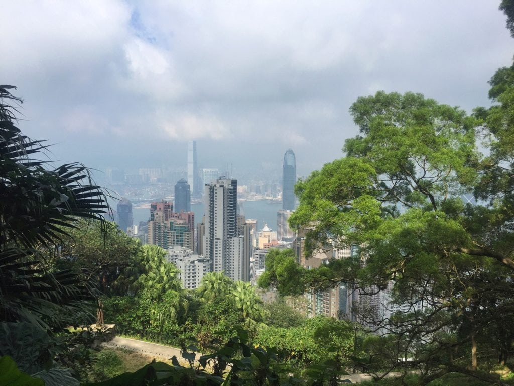 "The buildings peak out between the trees. - ""Don't Miss Victoria Peak When Visiting Hong Kong"" - Two Traveling Texans"