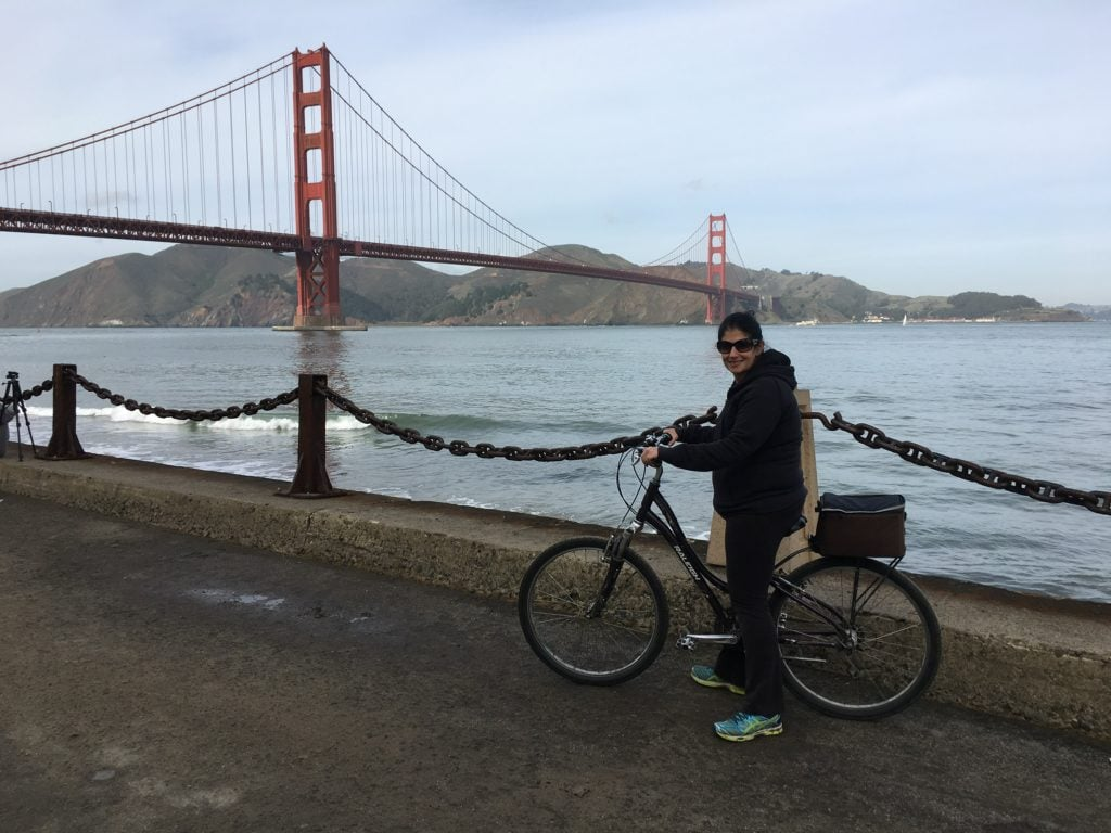 """Anisa on her bike headed to the Golden Gate Bridge. - """"Biking Across the Golden Gate Bridge: Another off my Bucket List!"""" - Two Traveling Texans"""
