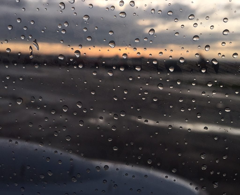 """A rainy sunset as seen from a plane at Newark Airport. - """"The Best Options for Traveling Between Manhattan and Newark Airport (EWR)"""" - Two Traveling Texans"""