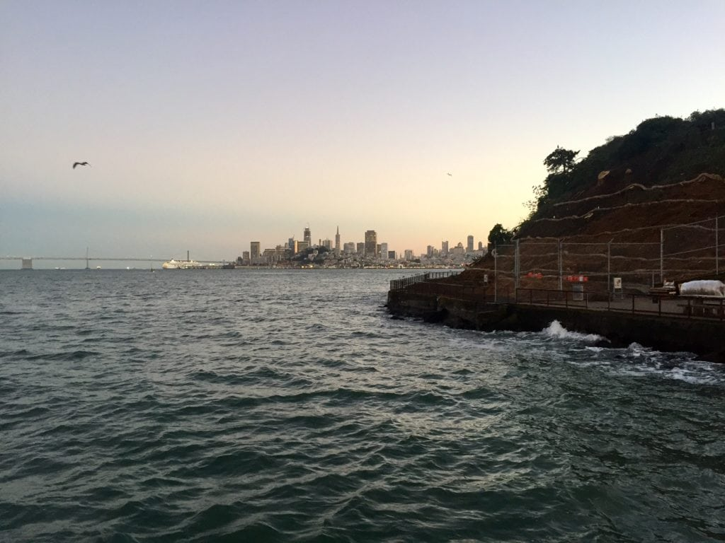 """You get a lovely view of San Francisco and the Bay Bridge as you dock at Alcatraz. - """"Spend One Night at Alcatraz"""" - Two Traveling Texans"""