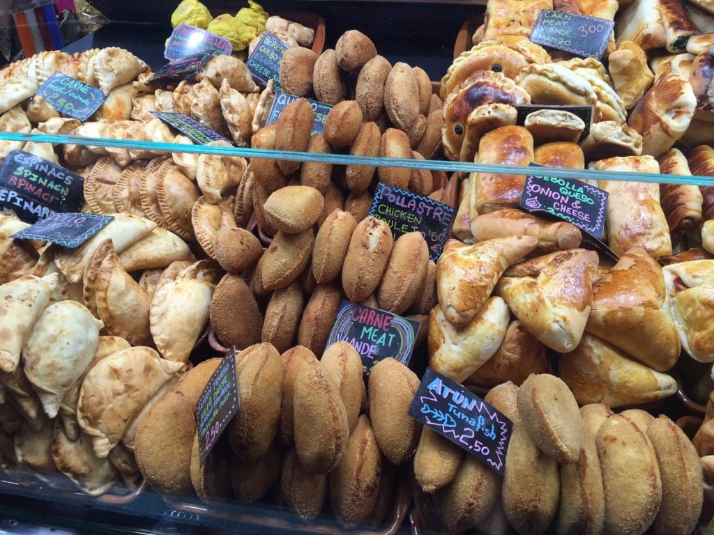 "Empanadas are one of my favorite foods! - ""La Boqueria Market - Come Hungry!"" - Two Traveling Texans"