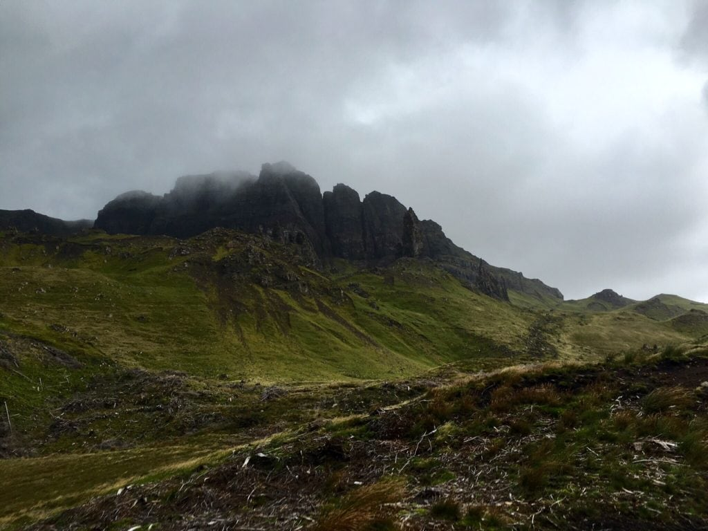 """Even in bad weather, Old Man of Storr is a beautiful place to hike. - """"Old Man of Storr: Hiking in the Clouds"""" - Two Traveling Texans"""