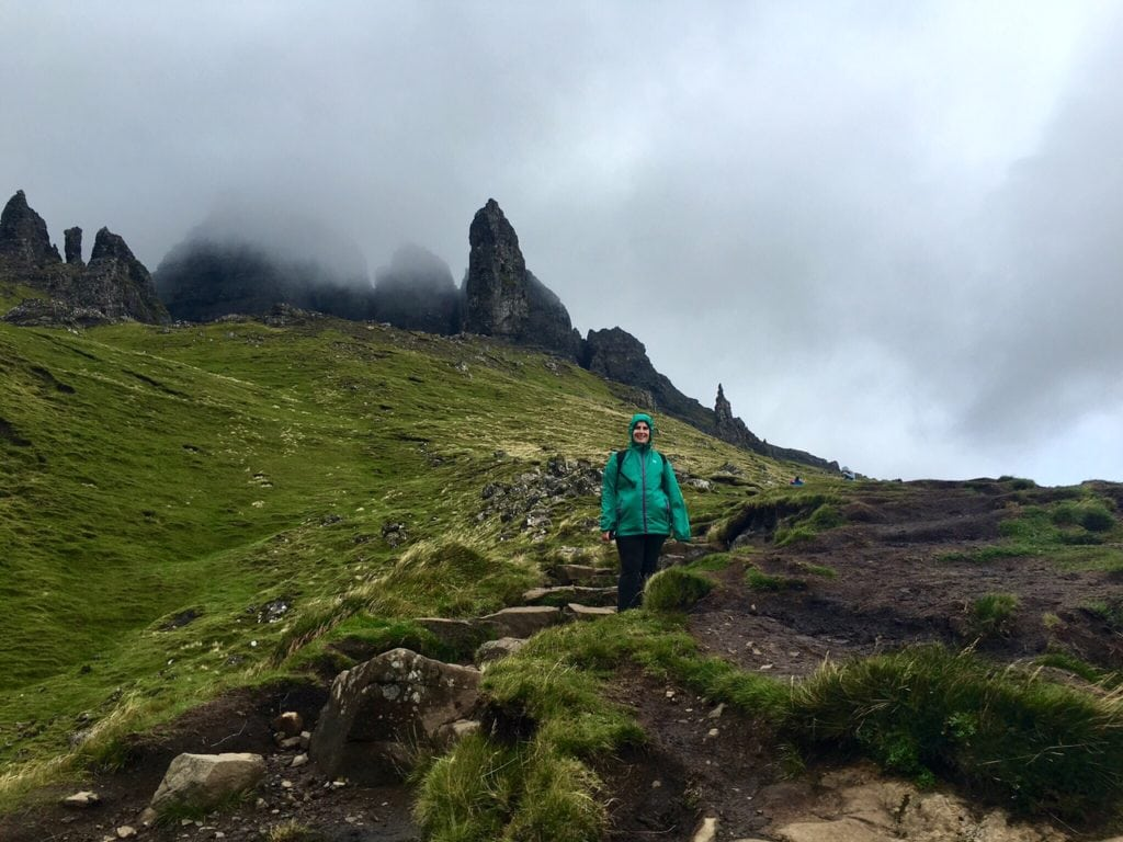 """Anisa climbing the steps towards the Old Man of Storr. - """"Old Man of Storr: Hiking in the Clouds"""" - Two Traveling Texans"""