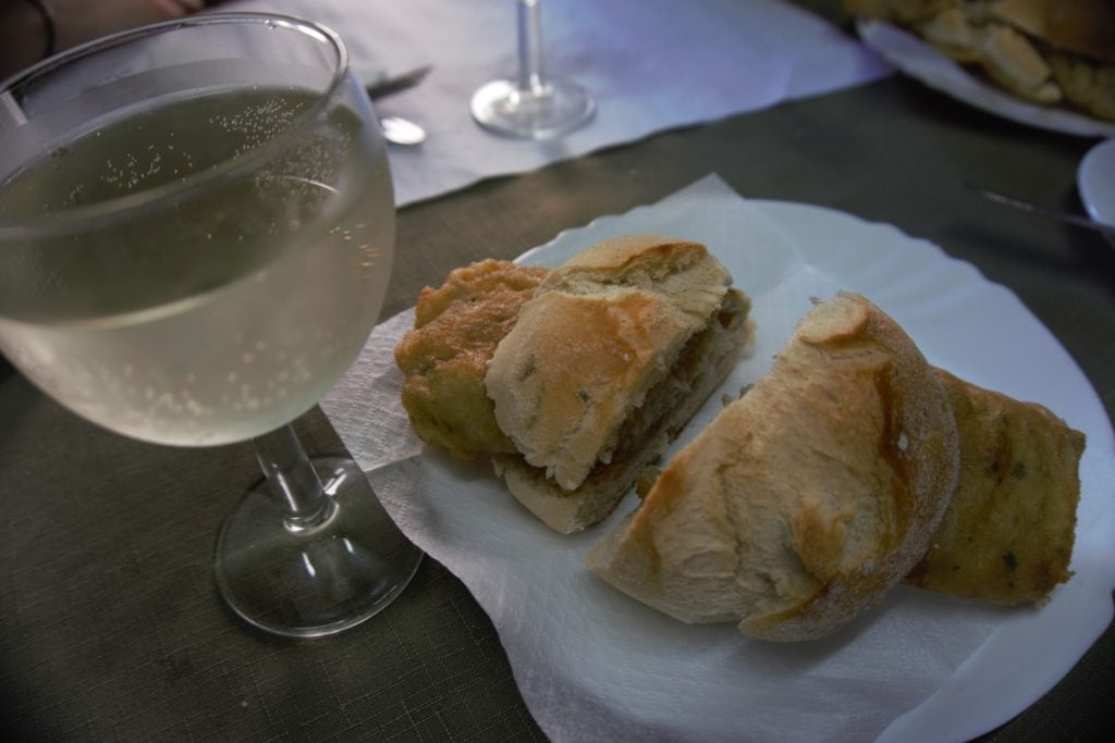"The salted cod sandwich with a glass (or two) of Vinho Verde. -""Porto Food Tour: Taste the Local Specialties"" - Two Traveling Texans"