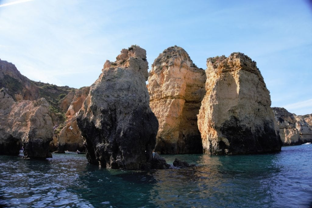 """As you get closer you realize the rock formations are more than just simple cliffs. - """"Algarve Caves By Boat with Bom Dia"""" - Two Traveling Texans"""