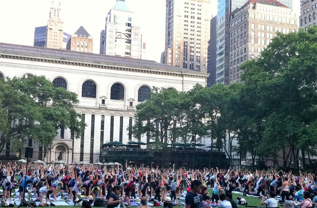 """So many yogis! A little bit of zen in the middle of midtown Manhattan. - """"The Best Free Summer Events in NYC"""" - Two Traveling Texans"""