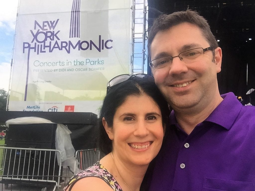 """Anisa and Russell close to the stage at the Philharmonic in the Park concert on the Great Lawn. - """"Best Free Summer Events in NYC"""" - Two Traveling Texans"""