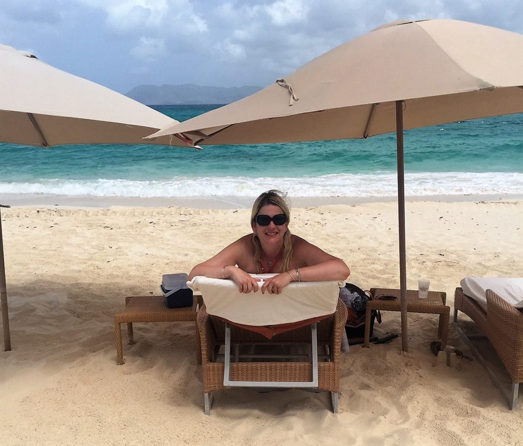 """Katherine enjoying our lounge chairs at Cap Juluca. - """"Beach Day Trip to Anguilla"""" - Two Traveling Texans"""
