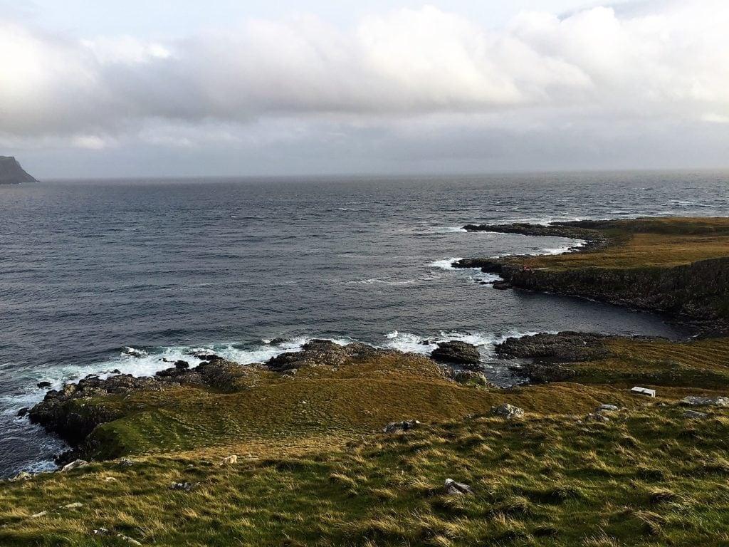 "I love the rugged coastline. - ""Neist Point Lighthouse: Best Sunset Spot on Isle of Skye?"" - Two Traveling Texans"