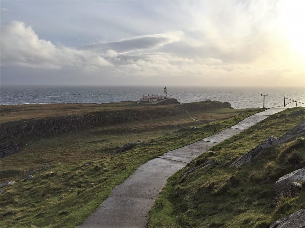 """You can see the Neist Point Lighthouse in the distance. - """"Neist Point Lighthouse: Best Sunset Spot on Isle of Skye?"""" - Two Traveling Texans"""