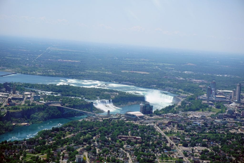 """Here you can see the Rainbow Bridge, the American Falls, the Bridal Falls, and the Horseshoe Falls. - """"Niagara Falls Helicopter Ride to Remember"""" - Two Traveling Texans"""