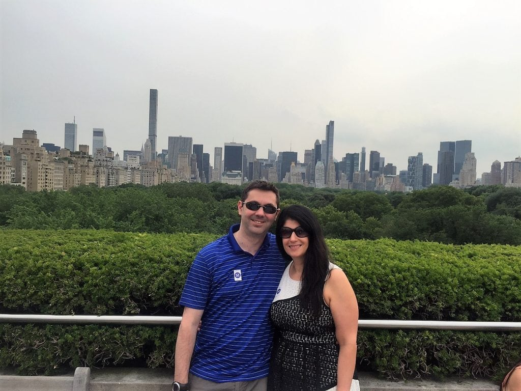 "Anisa and Russell on the Met Rooftop with midtown Manhattan in the background. - - ""Met vs MOMA: Which Museum is Best?"" - Two Traveling Texans"