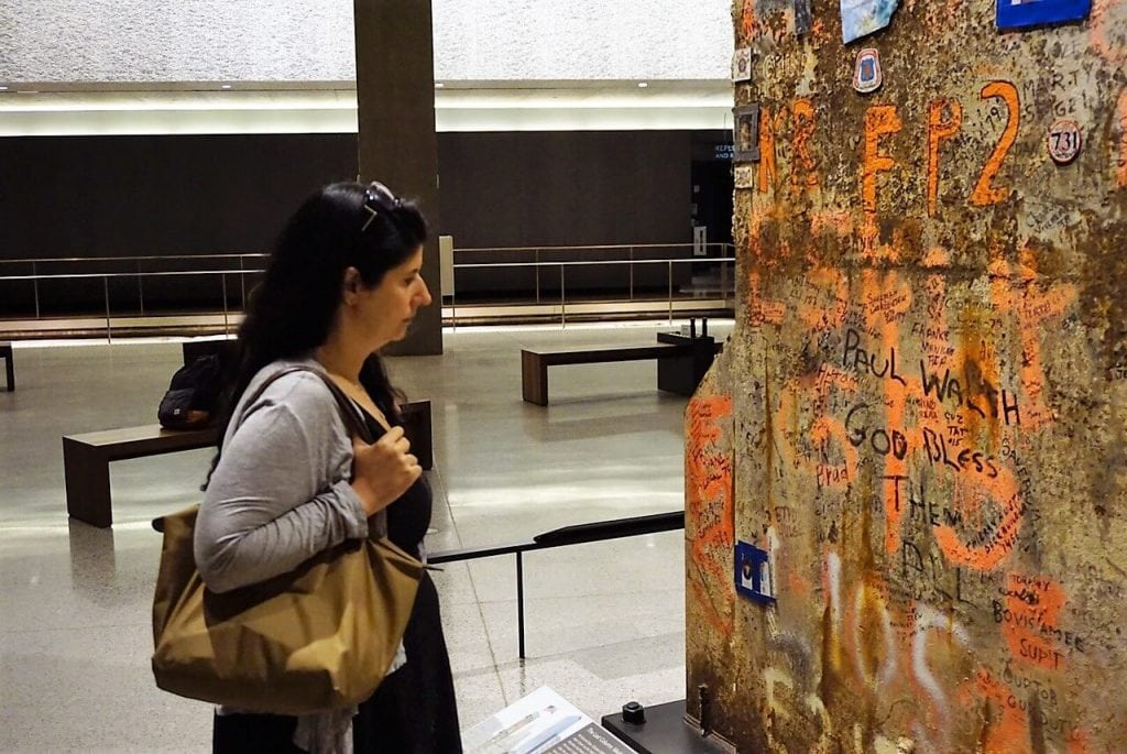 Anisa reading the message on the Last Column.